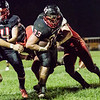 Oak Hill Runningback, Logan Lawhorn makes his way past a trio of Pikeview defenders. Chad Foreman for the Register-Herald.