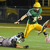 (Brad Davis/The Register-Herald) Greenbrier East ball carrier Colby Piner gets away from Woodrow Wilson defender Nicholas Wickline Friday night in Fairlea.