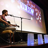(Brad Davis/The Register-Herald) Local musician Greg Lilly performs during the Women's Resource Center's 28th Annual Candlelight Vigil Thursday night inside The Raleigh Playhouse & Theatre.