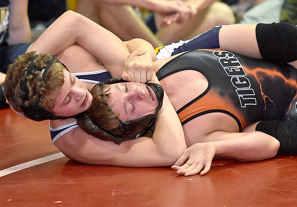 (Brad Davis/The Register-Herald) Nicholas County's Levi Brake, left, takes on Wirt's A.J. Garrett as the two square off in a 120-pound weight class matchup Saturday afternoon at the Summersville Arena and Convention Center. Nicholas' Brake would win the match.