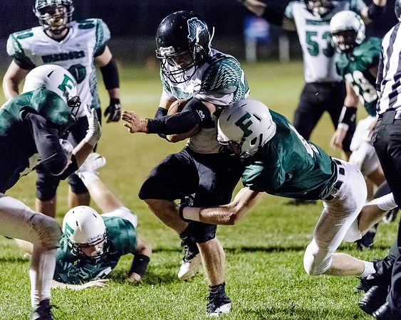 Eli Selvey of Fayetteville tackles Wyoming East's Caleb Bower, but he has already scored a touchdown. Chad Foreman for the Register-Herlad.