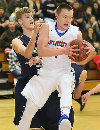 (Brad Davis/The Register-Herald) Midland Trail's Nathan Hanshew hauls in an offensive rebound as he beats Greenbrier West's Riley O'Dell for it Friday night in Hico.