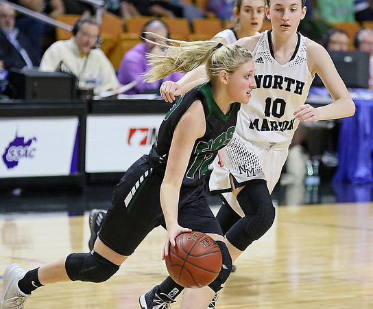 (Brad Davis/The Register-Herald) Wyoming East's Misa Quesenberry drives around North Marion's Hannah Shriver Saturday afternoon at the Charleston Civic Center.