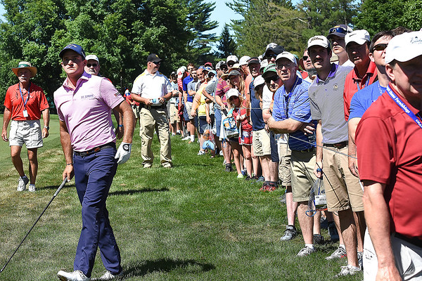 Sam Saunders and spectators watch his ball after he hit his secon shot par 5, 12th hole during A Military Tribute at The Greenbrier golf tournament held at The Greenbrier Resort in White Sulphur Springs.<br /> (Rick Barbero/The Register-Herald)