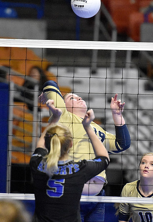 (Brad Davis/The Register-Herald) Greenbrier West's Reegan Lively spikes the ball as Tyler Consolidated's Josey Jones moves over to block during State Volleyball Tournament action Friday morning at the Charleston Civic Center.