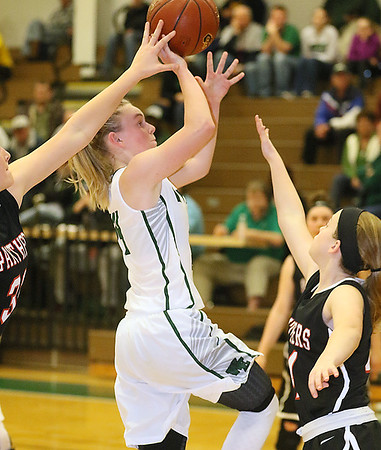 (Brad Davis/The Register-Herald) Wyoming East's Jazz Blankenship drives to the basket between PikeView defenders Laken McKinney, left, and Rebecca Johnson Thursday night in New Richmond.
