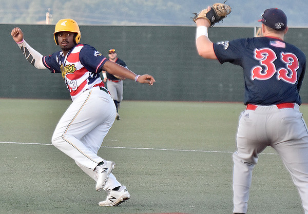 (Brad Davis/The Register-Herald) Miners baserunner Mason Washington gets caught in a rundown after failed attempt to steal 2nd as Chillicothe 1st baseman Andrew Czech, right, pursues him Saturday night at Linda K. Epling Stadium.