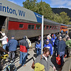 (Brad Davis/The Register-Herald) Activity bustles around the historic railroad depot as passengers exit following the arrival of the New River Train Excursion during Hinton Railroad Days Sunday afternoon.