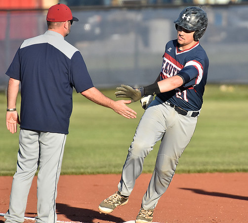 (Brad Davis/The Register-Herald) Bluefield's Drake Mullins gets kudos from his 3rd base coach after smashing a home run against the Tigers Wednesday evening in Shady Spring.