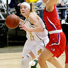 (Brad Davis/The Register-Herald) Greenbrier East's Abby Bartenslager drives to the basket as Morgantown's Aleena McDaniel defends during Big Atlantic Classic action Saturday the Beckley-Raleigh County Convention Center.
