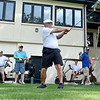 (Brad Davis/The Register-Herald) Fellow golfers look on waiting their turns to start as participant Woody Duba tees off during a special memorial tournament for late BNI Tournament winner Greg McGraw Thursday evening at Black Knight Country Club. McGraw was killed in a car accident in Tennessee earlier this month.