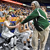 (Brad Davis/The Register-Herald) Wyoming East coach Angie Boninsegna congratulates her Lady Warriors during the final seconds of their State Tournament win over Wayne Friday morning at the Charleston Civic Center.