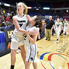 (Brad Davis/The Register-Herald) Wyoming East players Emily Saunders, left, and Katie Daniels celebrate following the Lady Warriors' State Tournament win over Wayne Friday morning at the Charleston Civic Center.