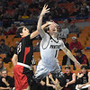 Seth Wolfe, Greater Beckley Christian, left, fouls Johnathan Blankenship, Tug Valley as he goes up for a shot during the quarter-final game of the Class A Boys State Basketball Tournament held at the Charleston Civic Center. <br /> (Rick Barbero/The Register-Herald)