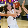 (Brad Davis/The Register-Herald) Woodrow Wilson's Laken Ball drives and scores as Morgantown's Sydni Clawges, left, and Kaitlyn Ammons defend during Big Atlantic Classic action Thursday night at the Beckley-Raleigh County Convention Center.