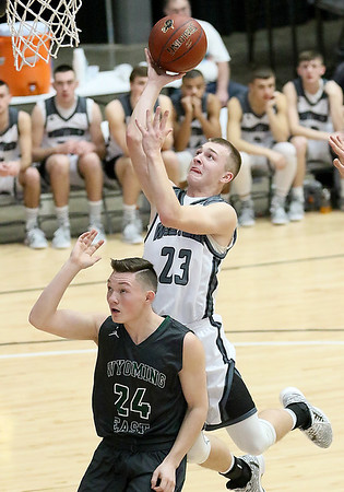 (Brad Davis/The Register-Herald) Westside's Jacob Ellis drives and scores as Wyoming East's Jared Cannady defends during Big Atlantic Classic action Saturday the Beckley-Raleigh County Convention Center.