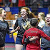 (Brad Davis/The Register-Herald) Indy players celebrate after scoring the final point to put away Oak Glen and advance during State Volleyball Tournament action Friday morning at the Charleston Civic Center.
