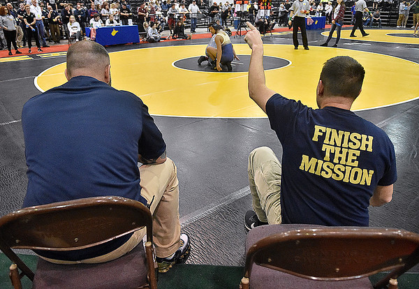 (Brad Davis/The Register-Herald) Greenbrier West coaches Jeremy and Steve Tincher instruct their wrestler Thursday night.