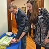 (Brad Davis/The Register-Herald) United Way of Southern West Virginia Executive Director Michelle Rotellini and 2017-18 Campaign Chair Austin Caperton cut a cake in celebration of the organization reaching its yearly fundraising goal Friday afternoon following the announcement at their Croft Street headquarters.
