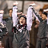 (Brad Davis/The Register-Herald) Woodrow Wilson cheerleaders, bundled up for the cold, perform during the Flying Eagles' home game against George Washington Friday night in Beckley.
