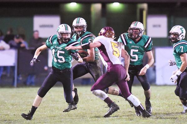 Fayetteville's Luke Vass (15) goes to block Sherman's Tommy Harper (5) during their high school football game Friday in Fayetteville. (Chris Jackson/The Register-Herald)