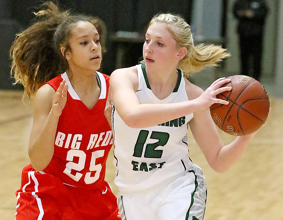(Brad Davis/The Register-Herald) Wyoming East's Misa Quesenberry drives to the basket as Parkersburg's Tavien Clark defends during Big Atlantic Classic action Wednesday night at the Beckley-Raleigh County Convention Center.