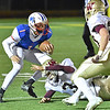 (Brad Davis/The Register-Herald) Midland Trail's Christopher Vines is bottled up by Williamstown defenders Carter Haynes (#3) and Eric Brown (#20) as he runs out of room Friday night in Fairlea.