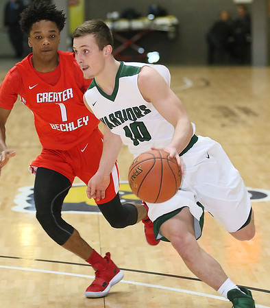 (Brad Davis/The Register-Herald) Wyoming East's Chase York drives to the basket as Greater Beckley Christian defender Elijah Edwards pressures during the Little General Battle for the Armory consolation game Saturday night at Beckley-Raleigh County Convention Center.