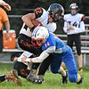 (Brad Davis/The Register-Herald) Midland Trail's Trevor Maichle sticks Richwood ball carrier Jeremiah Johnston Friday night in Hico.