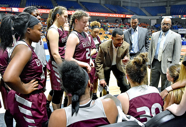 (Brad Davis/The Register-Herald) Woodrow Wilson coach Brian Nabors instructs his team during a timeout on the court against Parkersburg South Wednesday afternoon at the Charleston Civic Center.