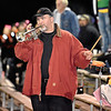 "(Brad Davis/The Register-Herald) Summers County alum Mike ""The Trumpet Man"" Wills, a one-man band who accompanies the Bobcats on road games, plays in celebration of a score Friday night in Meadow Bridge."