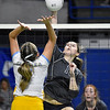(Brad Davis/The Register-Herald) Independence's Mykal Daniel spikes the ball as Oak Glen's Hanna Tice tries to block it during State Volleyball Tournament action Friday morning at the Charleston Civic Center.
