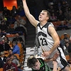 Jacob Ellis, of Westside, right, drives to the basket against, Christian Fyre, of Winfield, in the quarter-final game of the Class AA Boys State Basketball Tournament held at the Charleston Civic Center. Winfield won 68-65<br /> (Rick Barbero/The Register-Herald)