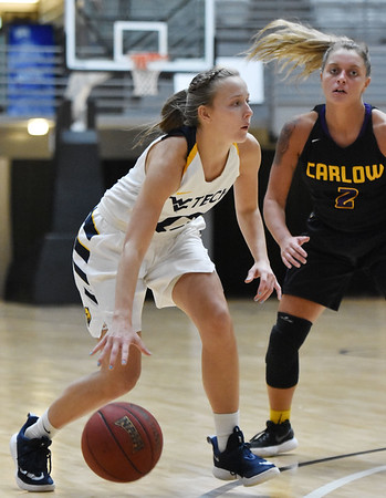 WVU Tech's Brittney Justice gets past Carlow's Delaney Daly during the third quarter of their college basketball game Tuesday in Beckley. (Chris Jackson/The Register-Herald)