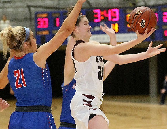 (Brad Davis/The Register-Herald) Woodrow Wilson's Elizabeth Cadle drives and scores against Morgantown during Big Atlantic Classic action Thursday night at the Beckley-Raleigh County Convention Center.