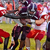 (Brad Davis/The Register-Herald) Woodrow Wilson's Micah Hancock plows through Parkersburg defenders Aurelius Edmonds, left, and Benjamin Barbarito for a touchdown Friday night in Beckley.