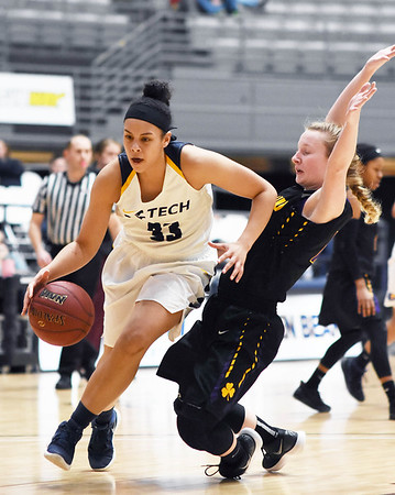 WVU Tech's Katelyn Byrd (33) gets past Carlow's Alexis Yanief (3) during the third quarter of their basketball game in Beckley Tuesday. (Chris Jackson/The Register-Herald)