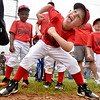 (Brad Davis/The Register-Herald) Bulldogs player Caleb Hamb, 5, notices the camera and reacts accordingly as he and young teammates struggle to keep still while waiting in line during team introductions, part of Beckley Little League's Tee Ball Opening Day ceremonies Saturday afternoon.