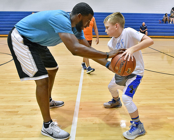 (Brad Davis/The Register-Herald) Former Concord University player Cam Shannon helps out during Herbie Brooks Fundamentals Camp Saturday afternoon at Beckley-Stratton Middle School.