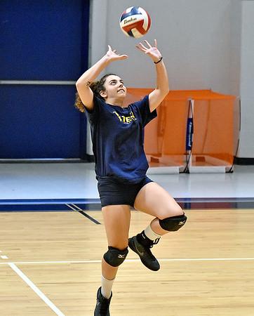 (Brad Davis/The Register-Herald) WVU Tech volleyball player Konstantina Pateli sets the ball as she and teammates run drills during practice Wednesday evening inside the Van Meter Gymnasium.