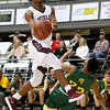 (Brad Davis/The Register-Herald) Woodrow Wilson's Ty Walton drives to the basket as Greenbrier East's Bryson Penn defends Saturday night at the Beckley-Raleigh County Convention Center.