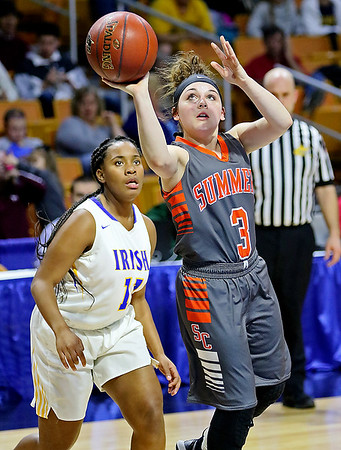 (Brad Davis/The Register-Herald) Summers County's Riley Richmond drives to the basket as St. Joseph Central's Essence Sims defends Friday night at the Charleston Civic Center.