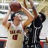 Oak Hill's Dante Billeter (15) gets a shot off over Bluefield's Albert Coleman (25) during their basketball game Tuesday in Oak Hill. (Chris Jackson/The Register-Herald)