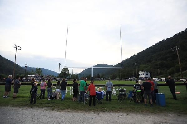 Fans wait for kickoff of the last time Fayetteville and Valley play each other in a high school football game in Smithers on Friday. The two Fayette County schools are closing due to consolidation next year. (Chris Jackson/The Register-Herald)