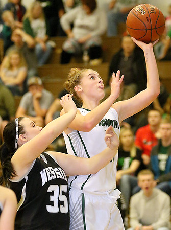 (Brad Davis/The Register-Herald) Wyoming East's Kara Sandy drives and score as Westide's Caitlin Bleigh defends Thursday night in New Richmond.