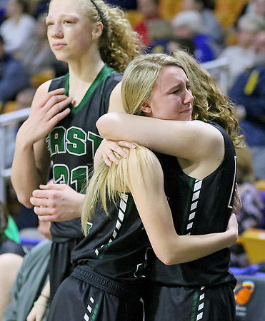 (Brad Davis/The Register-Herald) Wyoming East senior Gabby Lupardus consoles teammates following the Lady Warriors' Class AA State Championship game loss to North Marion Saturday afternoon at the Charleston Civic Center.