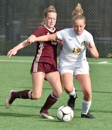 (Brad Davis/The Register-Herald) Greenbrier East's Ashley Thompson battles for possession with Woodrow Wilson's Hattie Hall Friday evening at the YMCA Paul Cline Memorial Soccer Complex.