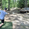 "(Brad Davis/The Register-Herald) Disc golfer Austin Buckland ""tees off"" on hole #1 of a brand new disc golf course at Daniel Vineyards Friday afternoon."