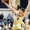 Shady Spring's Ryan Riffe (4) defends a shot from Westside's Corey Hatfield (44) during the first half of there regional basketball championship Thursday in Clear Fork. (Chris Jackson/The Register-Herald)