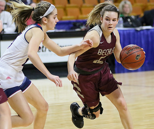 (Brad Davis/The Register-Herald) Woodrow Wilson's Cloey Frantz drives against Parkersburg South Wednesday afternoon at the Charleston Civic Center.